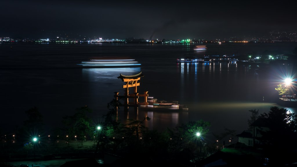 Long exposure of Miyajima Torii and party boat