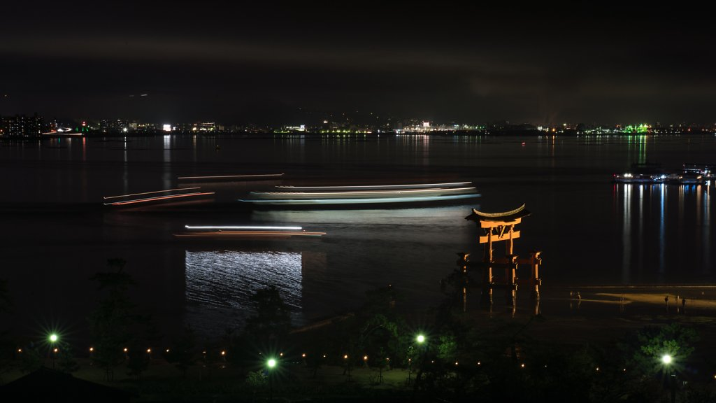 Long exposure of ferries and party boats