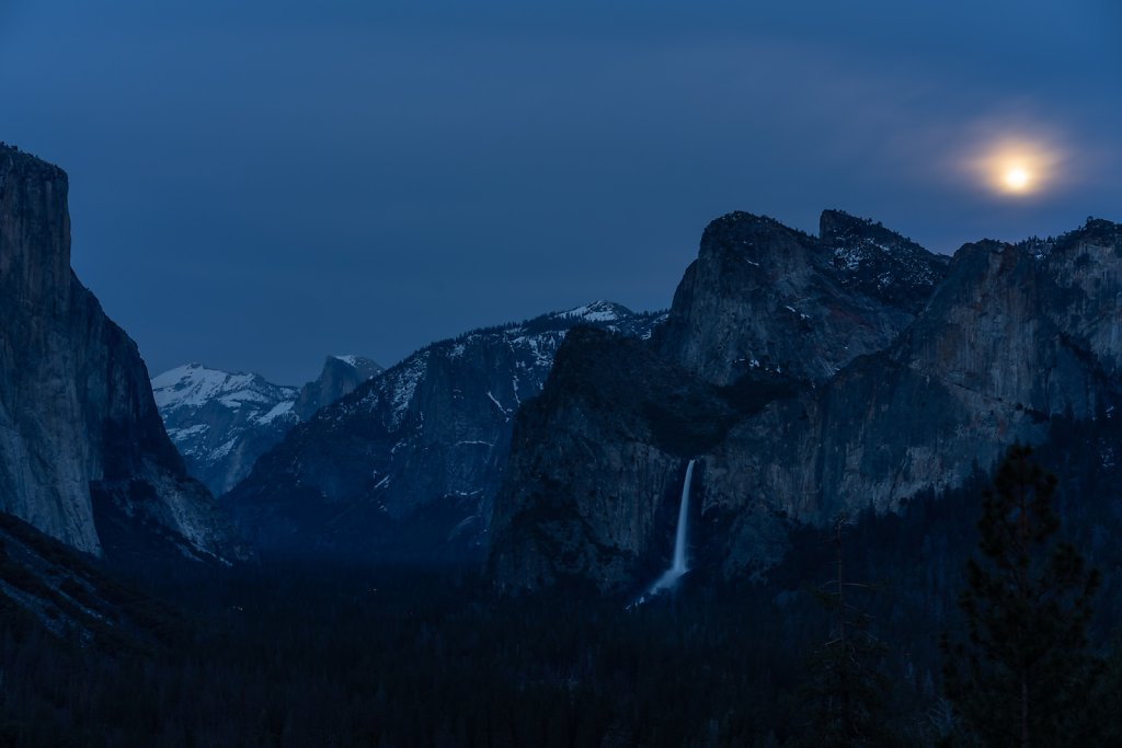Moonrise behind the clouds over Bridalveil Falls